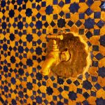 Golden Tap and Tiled Wall in Fes, Morocco